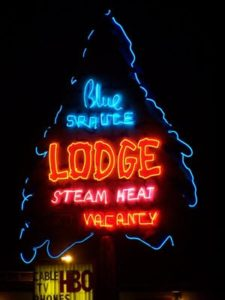 Neon Lodge Sign - Image by Joseph Novak on flickr